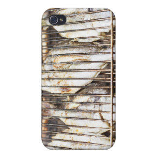 Sea breams on barbecue grill. case for iPhone 4