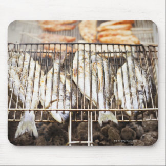 Sea breams on barbecue grill. mouse pad