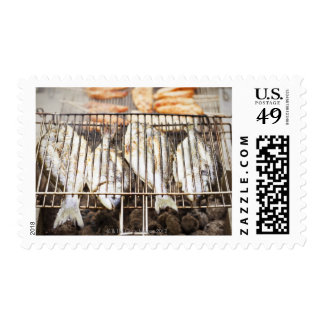 Sea breams on barbecue grill stamps