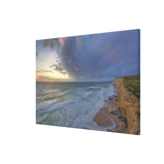 Sea cliffs catch days last light at Pomponi Canvas Print