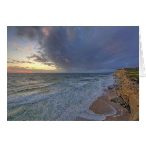 Sea cliffs catch days last light at Pomponi Greeting Card