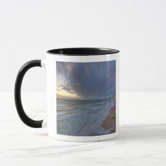 Sea cliffs catch days last light at Pomponi Mug