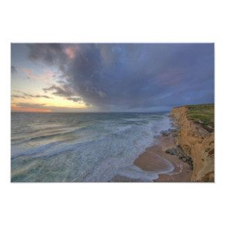 Sea cliffs catch days last light at Pomponi Photo Print