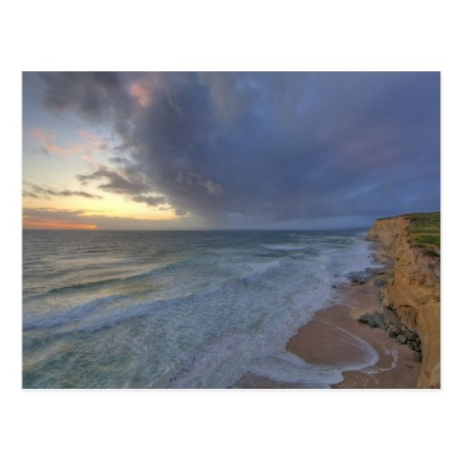 Sea cliffs catch days last light at Pomponi Postcard