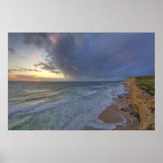 Sea cliffs catch days last light at Pomponi Print
