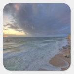 Sea cliffs catch days last light at Pomponi Square Stickers