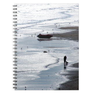 Sea coming to shore at dusk spiral notebook
