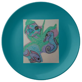 Sea creatures in green. plate