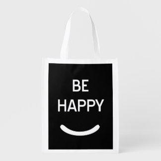 Sea feliz bolsas de la compra
