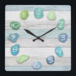 "Sea Glass Beach Driftwood Ocean Square Wall Clock<br><div class=""desc"">A sea glass and driftwood beach look clock. The wood is weathered looking and looks very real. Beautiful,  peaceful,  natural and rustic looking. Ideal for a beach house or for anyone who loves the ocean.</div>"