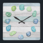 """Sea Glass Beach Driftwood Ocean Square Wall Clock<br><div class=""""desc"""">A sea glass and driftwood beach look clock. The wood is weathered looking and looks very real. Beautiful,  peaceful,  natural and rustic looking. Ideal for a beach house or for anyone who loves the ocean.</div>"""