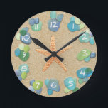 "Sea Glass Sand Starfish Round Clock<br><div class=""desc"">A sea glass and sand with a starfish beach look clock.Ideal for a beach house or for anyone who loves the ocean.</div>"