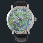 "Sea Glass Watch<br><div class=""desc"">Sea glass, or beach glass as it&#39;s sometimes known, makes so many wonderful products. This watch would be ideal for any lover the beach and ocean. Watch for some of our other glass on watches as well. There is blue, green, red, aqua, yellow, purple, all mixed or separately. Have fun...</div>"