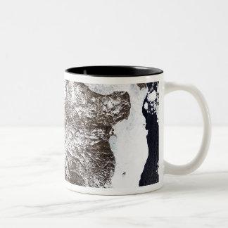 Sea ice lines the shoreline in eastern Greenlan Two-Tone Coffee Mug