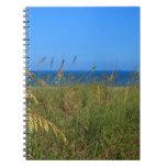 Sea oats beach dune ocean and sky photo spiral notebook