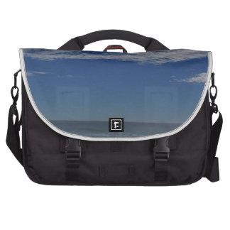 sea ocean sky clouds water air laptop bag