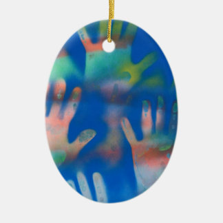 Sea of Hands, Orange and Green on blue Double-Sided Oval Ceramic Christmas Ornament