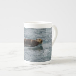 sea otter and baby tea cup