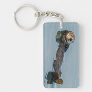 Sea otter floating on back in ocean keychain