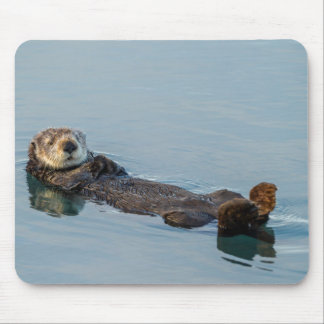 Sea otter floating on back in ocean mouse pad