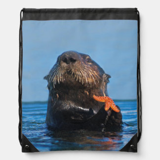 Sea Otter in Morro Bay Shows Off Red Starfish Drawstring Backpack