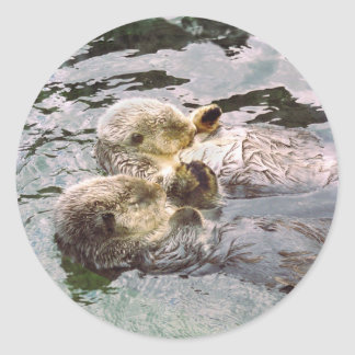 Sea Otters Holding Hands Round Stickers