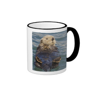 Sea otters play on icebergs at Surprise Inlet Ringer Mug