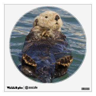 Sea otters play on icebergs at Surprise Inlet Wall Decal