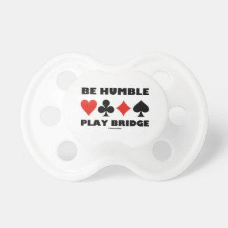 Sea puente humilde del juego cuatro juegos de la chupete
