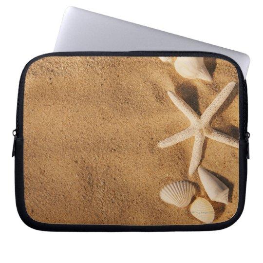Sea shells on sand laptop sleeve