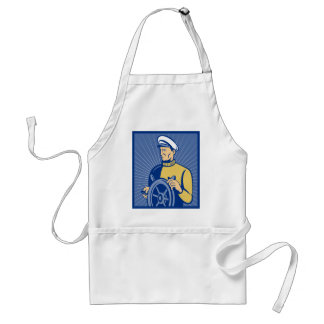 Sea ship captain at the helm steering wheel apron