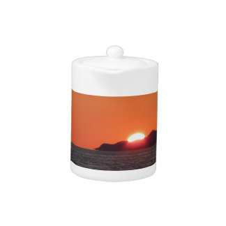 Sea sunset with island silhouette panorama teapot