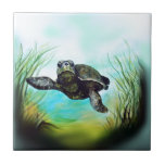 """Sea Turtle Ceramic Tile<br><div class=""""desc"""">Surrounded by aquamarine waters,  delicate lighting and warm green ocean plants,  this sea turtle swims serenely through the water in a magical undersea adventure.</div>"""