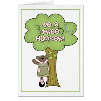 Sea una tarjeta de felicitación de Hugger del árbo