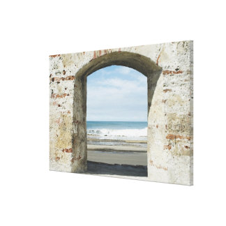 Sea viewed from an archway canvas print