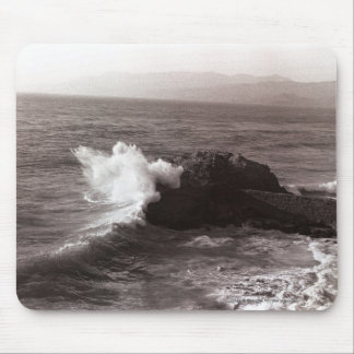 Sea waves crashing against rock mouse pads