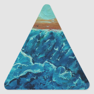 Seabirds among the waves triangle sticker