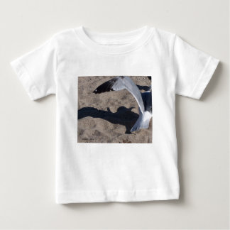 Seagull and shadow. Neat effect on sand! Baby T-Shirt