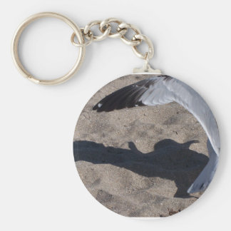 Seagull and shadow. Neat effect on sand! Basic Round Button Keychain