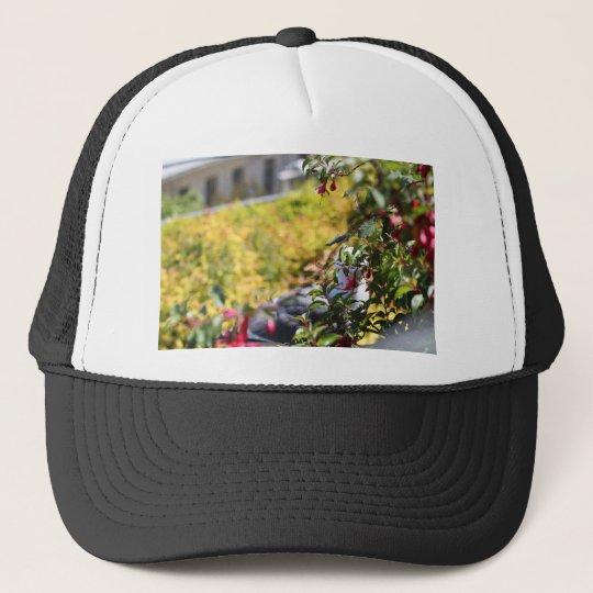 Seagull behind a field of flowers trucker hat