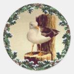 SEAGULL & FIR WREATH by SHARON SHARPE Round Sticker