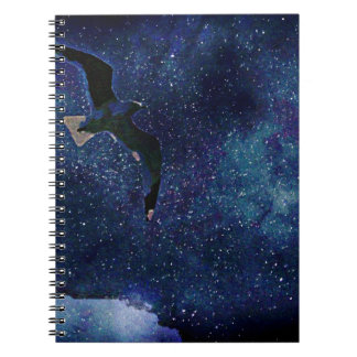 Seagull flying at night notebook