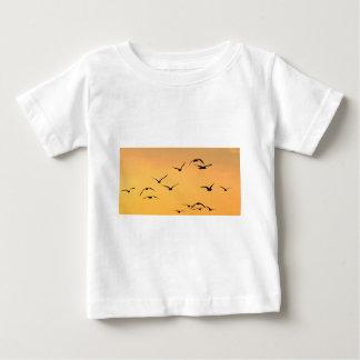 Seagull flying at night t shirt