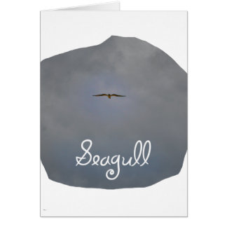 Seagull flying in a grey sky with text Seagull Card