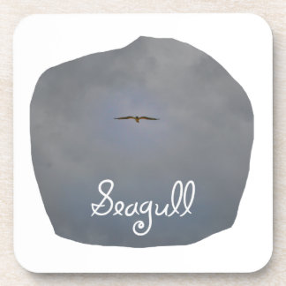Seagull flying in a grey sky with text Seagull Drink Coasters