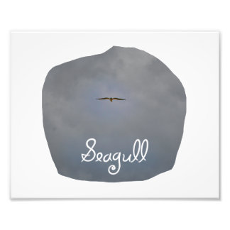 Seagull flying in a grey sky with text Seagull Photo Print