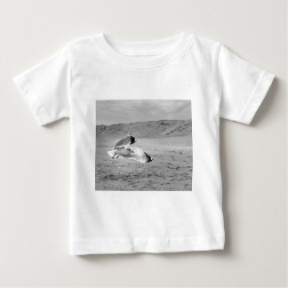 Seagull Flying Low Over Beach Sand Baby T-Shirt