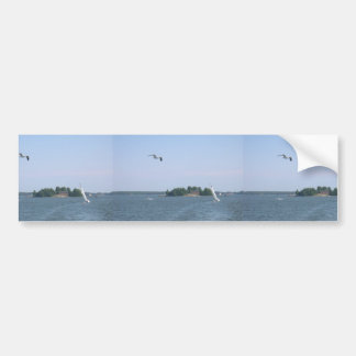 Seagull Flying Near The Island And Yacht At Helsin Bumper Sticker