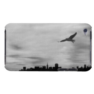 Seagull flying over skyline barely there iPod cases