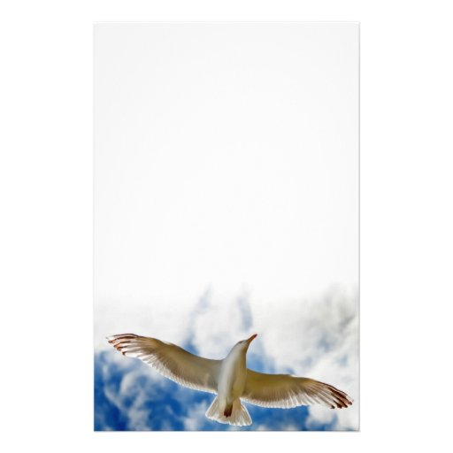 Seagull gliding in flight close up with blue skies stationery design